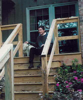 [Charlie with Snowy the dog on his cousin Caroline Peytons porch in 1996]